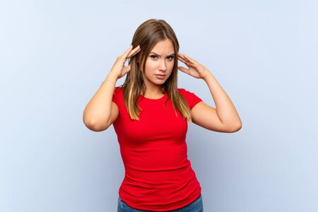 Teenager girl over isolated blue background unhappy and frustrated with something. Negative facial expression