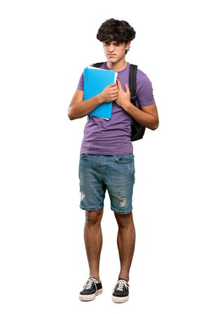 A full-length shot of a Young student man having a pain in the heart over isolated white background