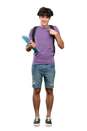 A full-length shot of a Young student man with surprise facial expression over isolated white background Banco de Imagens