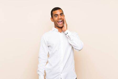 Young handsome brunette man over isolated background with surprise and shocked facial expression
