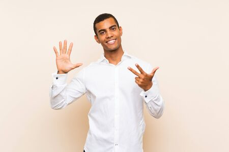 Young handsome brunette man over isolated background counting eight with fingers
