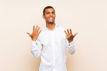 Young handsome brunette man over isolated background counting nine with fingers