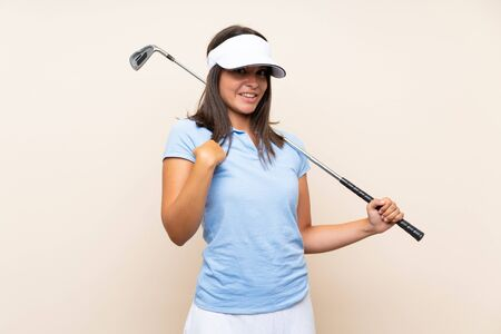 Young golfer woman over isolated background with surprise facial expression