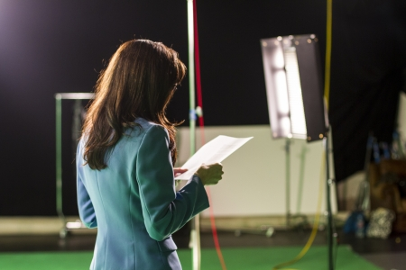 scripts: Actress Holding Script Rehearsing in Set Stock Photo