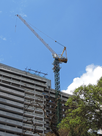 A building under construction with coupled crane