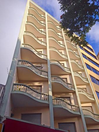 Facade of a building with wavy balconies Imagens