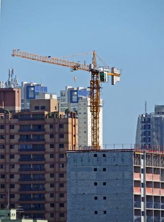 A building under construction with coupled crane Reklamní fotografie - 100456622