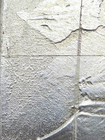 Irregular silver ink texture applied with a spatula