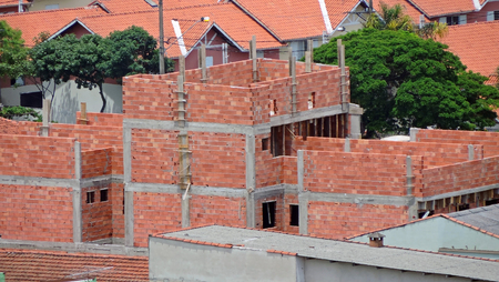 A house under construction with red bricks