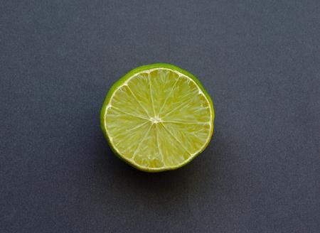 A half lemon on the dark background