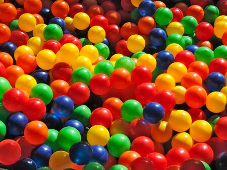 A pool of many colorful plastic balls