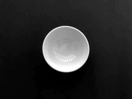 An empty bowl on the dark background 写真素材