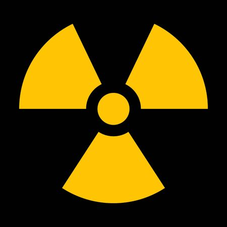 Yellow radiation sign isolated on dark background