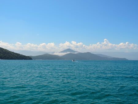 Silhouette of the Serra do Mar in Ubatuba, green mountains seen from the sea