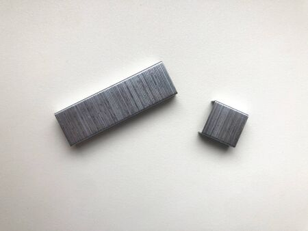 Closeup of set of metal staples lying on white background Imagens