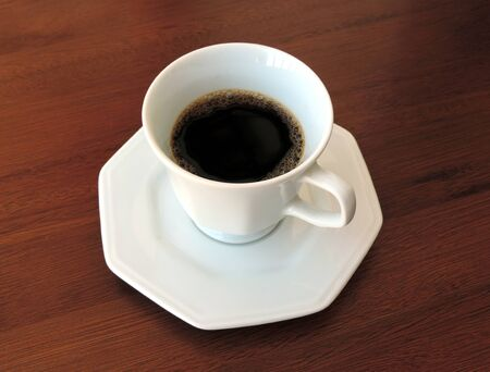 A coffee cup on the wooden table