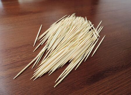 Close up many wooden toothpicks on the table