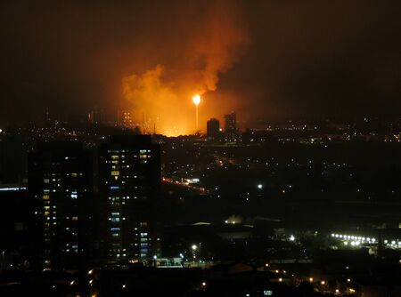 Petrochemical flare at night in Santo Andre city, Brazil