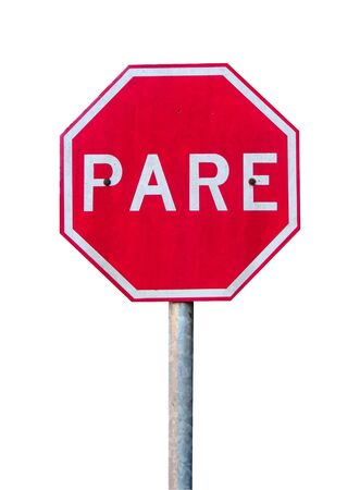Pare Traffic Sign. The portuguese sign for Stop, isolated on white background. Banco de Imagens