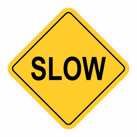 Slow traffic sign isolated on white background
