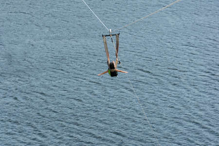 6 year old child going down with the zip line in the Jacoma Lagoon in the city of Ceara-Mirim / RN-Brazil.