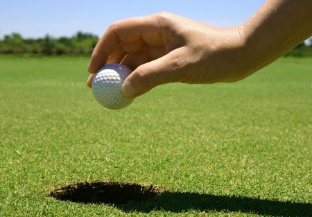 picking up: Picking up the golf ball