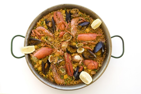 Spanish paella served on a dish with a white background