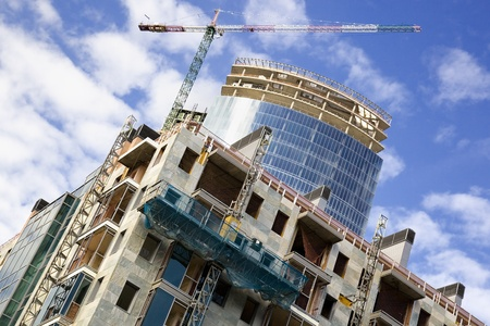 Skyscraper and apartment building under construction