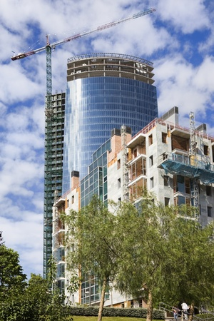 Skyscraper and apartments buildings under construction Standard-Bild