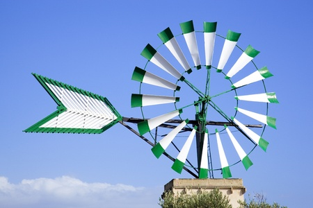 Isolated white and green windmill in Majorca with a blue sky as background Stock Photo - 12980861
