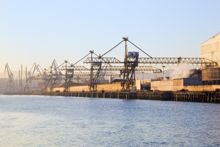 industrialized: Sea port cranes close to the scrap yard of a steel mill