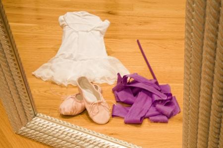 Ballet tutu, shoes and ribbon viewed through a mirror Standard-Bild