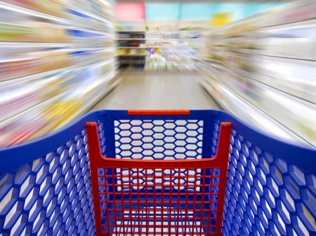 Trolley over a blurred background in a supermarket as a concept of fast shopping
