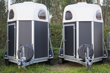 Two horse trailers parked in the forest Zdjęcie Seryjne