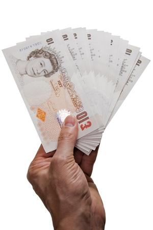 Hand giving several pounds notes on white Stock Photo