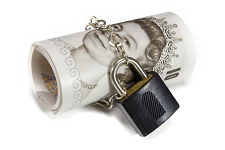 bank notes: English bank notes protected with a lock Stock Photo