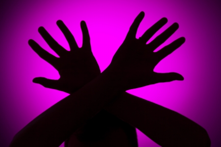 Phisical abuse concept on a pink background