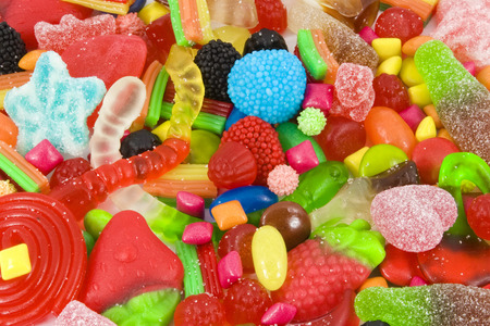 multicolored gumballs: Close view of a collection of multicolored sweets Stock Photo