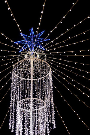outdoor lighting: Outdoor Christmas lighting with a blue star