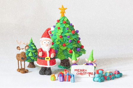 clay modeling: Handmade modelling clay Santa Claus and others wishing Merry Christmas Stock Photo