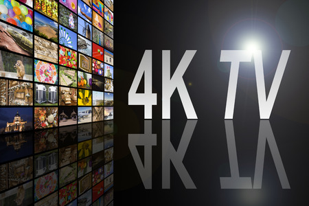 Concept of 4K TV on black background with reflection