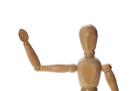 gesticulate: Wooden mannequin waving hello or goodbye
