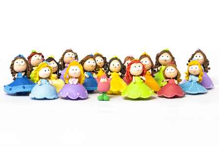 Milticolored set of handmadetoy dolls made with modelling clay