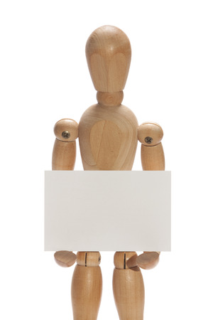 wooden mannequin: Isolated wooden mannequin holding blank white card