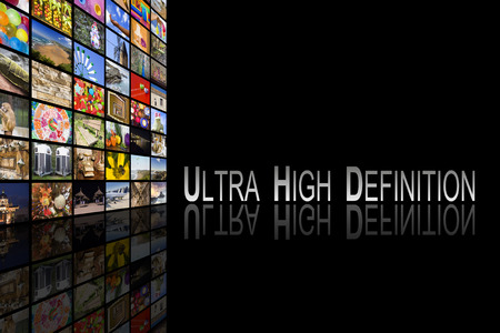 high definition: Concept of Ultra High Definition TV on black background with reflection Stock Photo