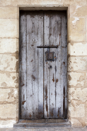 weathered: Aged wooden closed door in an old house