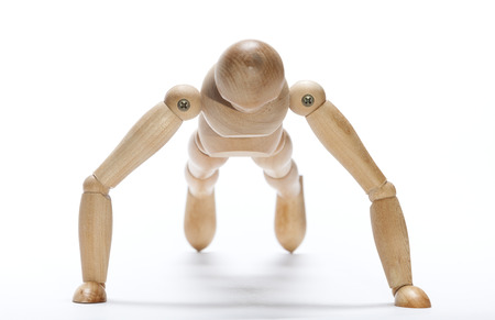 wooden mannequin: Selective focus on a wooden mannequin doing push-up exercise