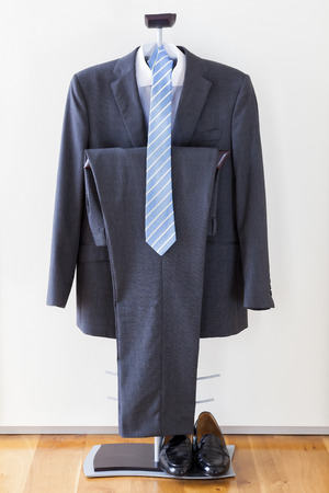 tailored: Suit, tie, shoes and white shirt as a concept of business Stock Photo