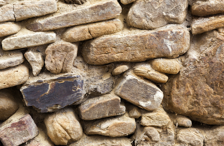 old building facade: Old masonry stone wall from and aged building facade