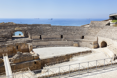 amphitheater: Roman amphitheater in Tarragona city, with the mediterranean sea as background Stock Photo